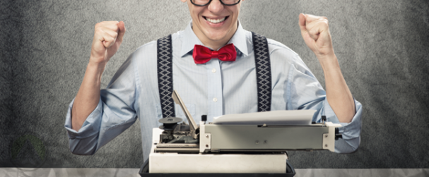 excited-writer-in-bowtie-suspenders-in-front-of-typewriter