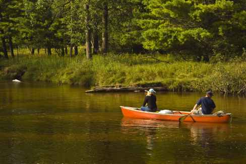 adventure boat canoe couple