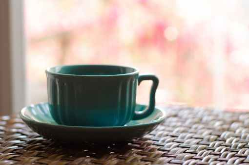 teal ceramic cup and saucer