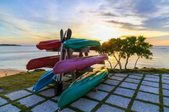 six assorted kayak boats