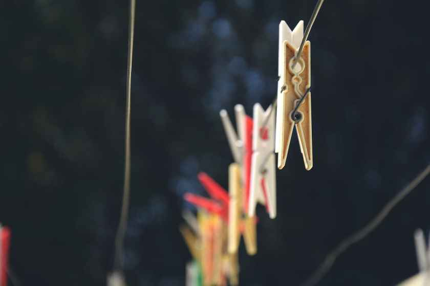 colors outdoors hanging clothespins