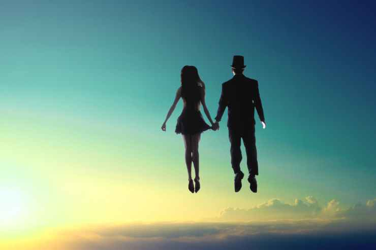 man and woman floating on sky