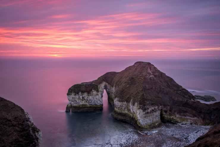rocky cliff on sea