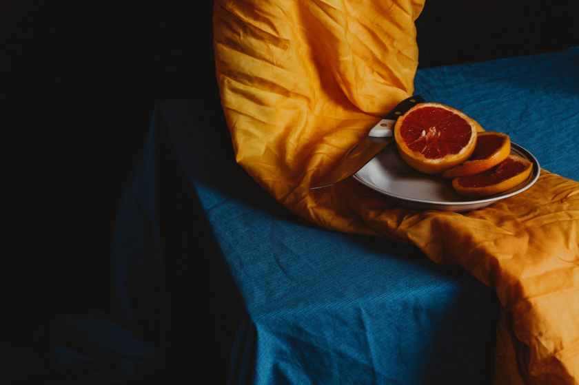 orange fruit on brown round plate
