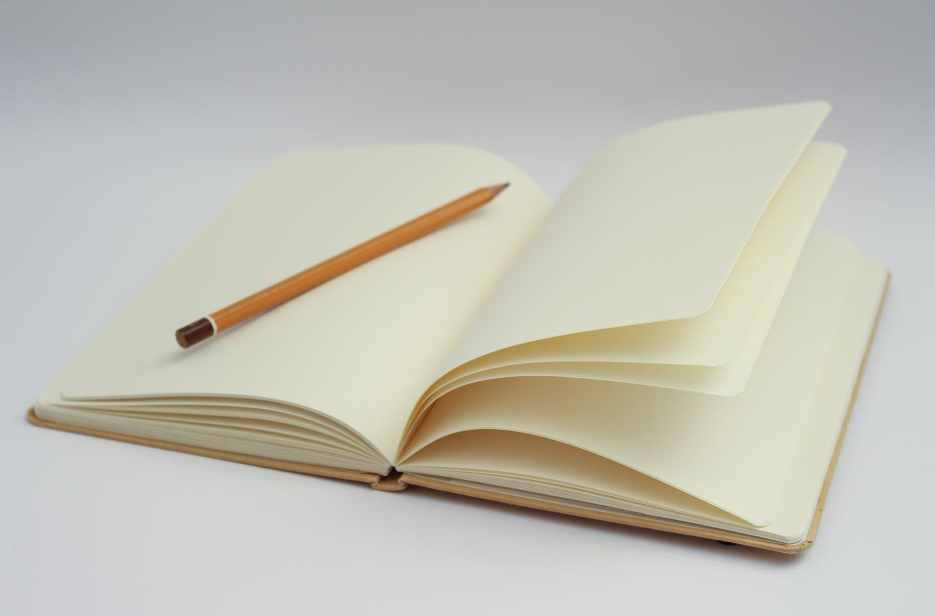 notebook writing pencil start