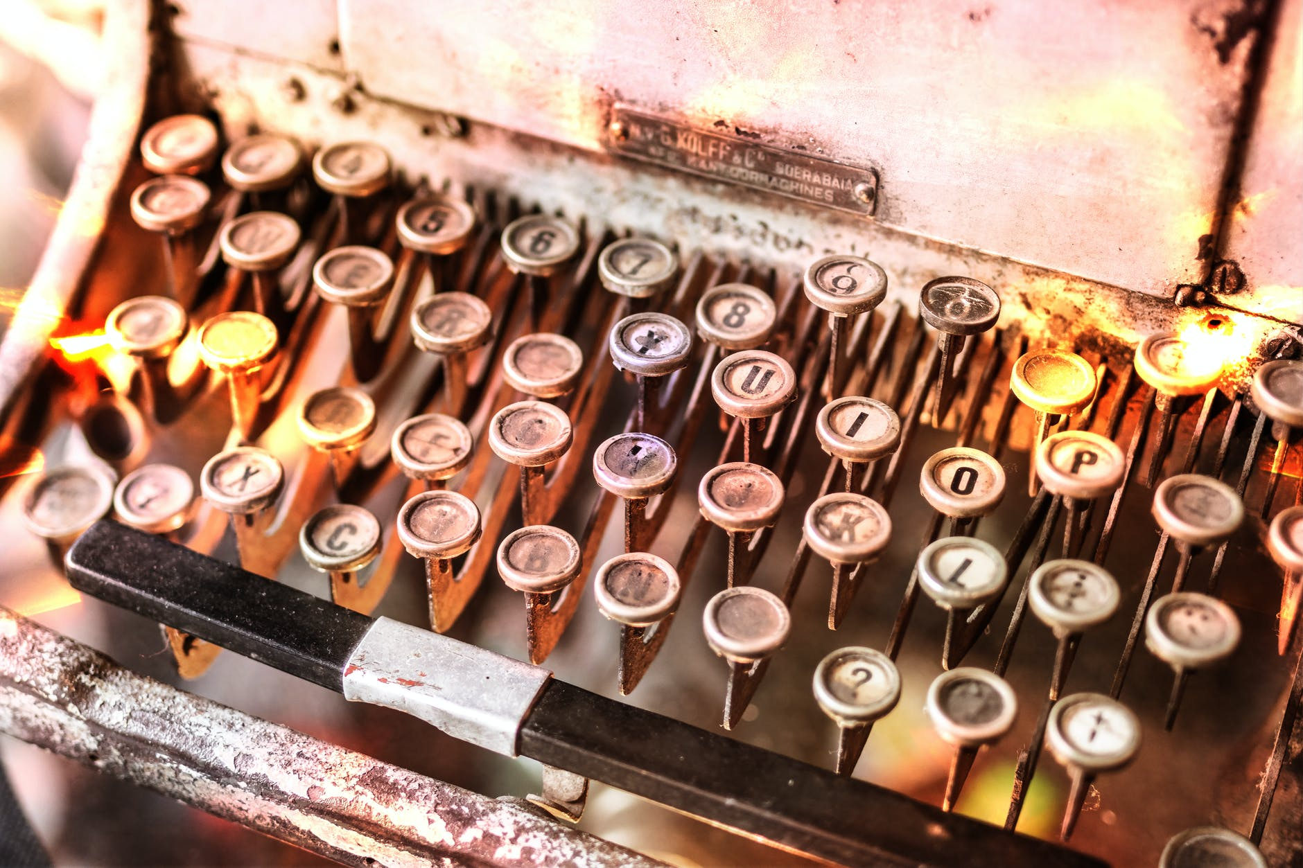 close up photo of vintage brown typewriter