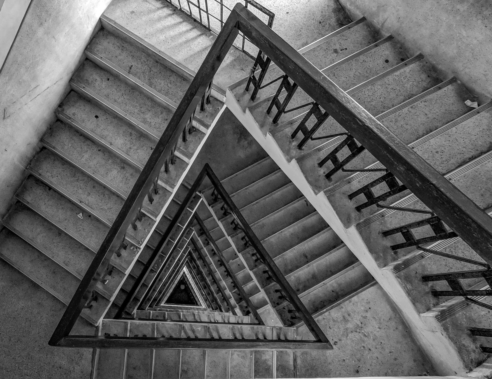 multi floor stairs grayscale photo
