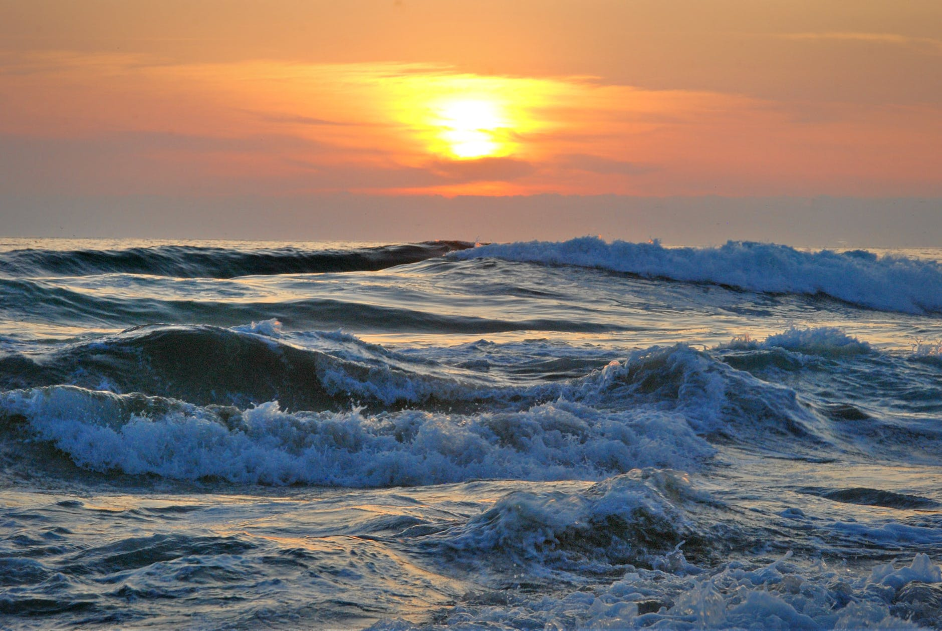 ocean water during yellow sunset